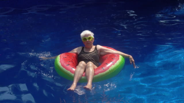 Portrait of Senior Woman Enjoying Life by the Pool Summer Festive Attitude