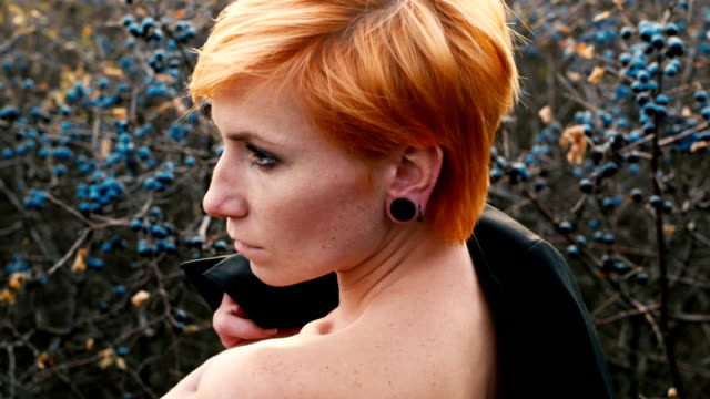 Portrait of sensual red-haired woman video