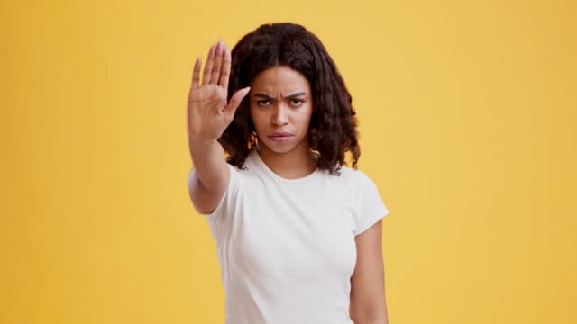 portrait of serious african american girl making stop gesture with hand - нетерпеливый стоковые видео и кадры b-roll