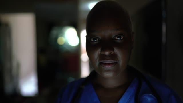 Portrait of serious female doctor/ nurse