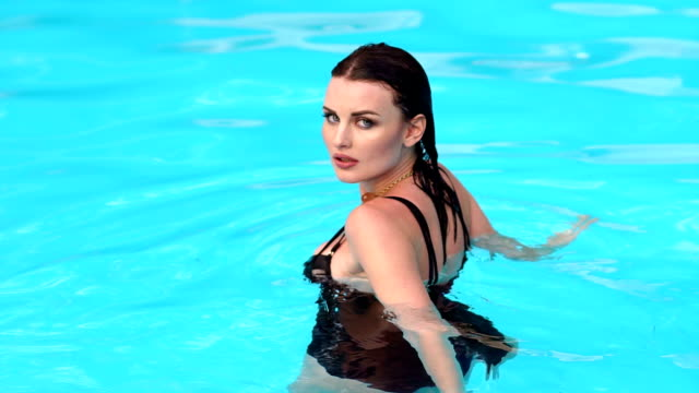 Portrait of sexy wet girl in the pool. video
