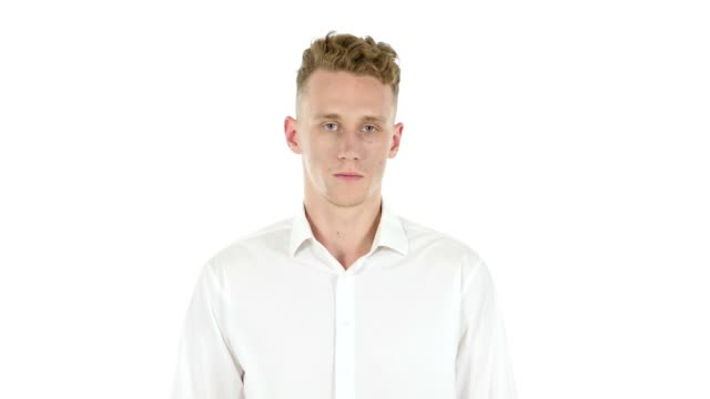 Portrait of  Shocked Young Businessman, White Background video
