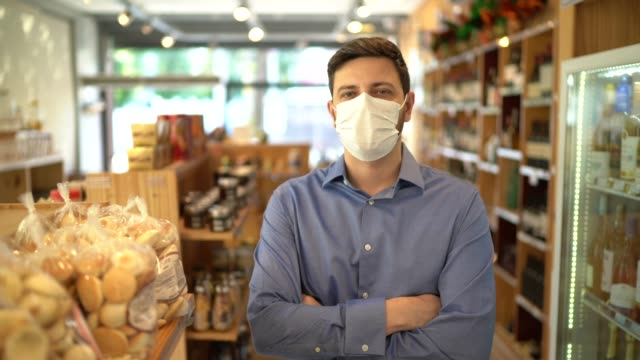 Portrait of small business man owner with face mask video