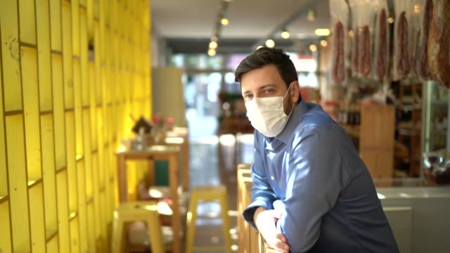 portrait of small business man owner with face mask - businessman covid mask video stock e b–roll