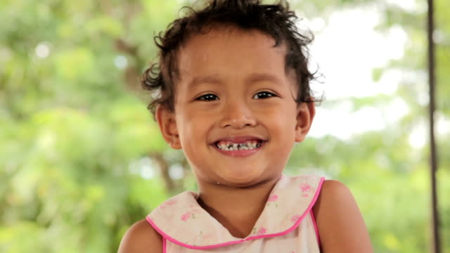 Portrait of smile asian poor girl in Thailand video