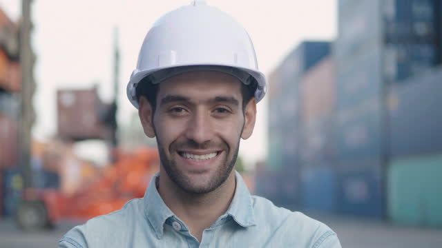 Portrait of smile middle eastern ethnicity businessman or male engineer age 25 yearold looking at camera of confidence at commercial transport background.Pride in Work concept.