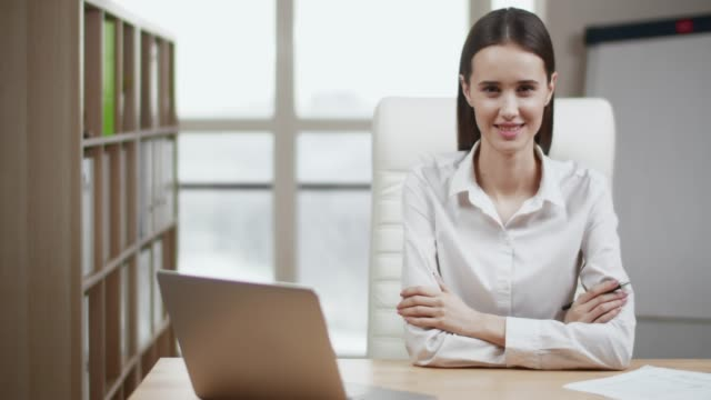 portrait of smiling businesswoman looking at camera posing - treedeo stock videos and b-roll footage