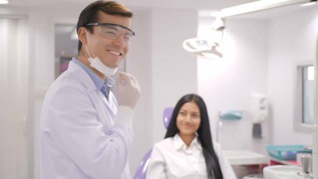 portrait of smiling caucasian dentist - dentist stock videos & royalty-free footage
