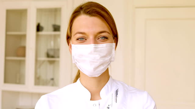 portrait of smiling female doctor in white office - infermiera personale medico video stock e b–roll