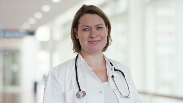 Portrait of smiling healthcare worker at hospital Confident female doctor in lab coat. Portrait of smiling healthcare worker at medical clinic. She is wearing stethoscope. female doctor stock videos & royalty-free footage