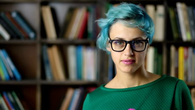 Portrait of smiling hipster girl in eyeglasses video
