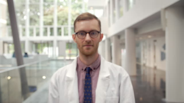 Portrait Of Smiling Male Doctor In Lobby Of Hospital video