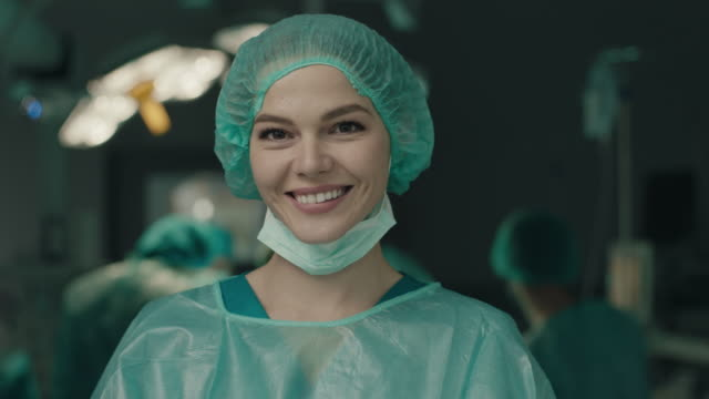 Portrait of smiling nurse in operating room video