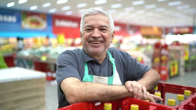 Portrait of smiling senior supermarket employee video