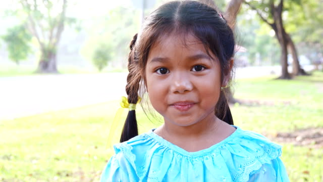 Portrait of smiling Thailand girl. video