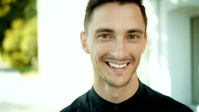 portrait of smiling young man - 20 24 lata filmów i materiałów b-roll