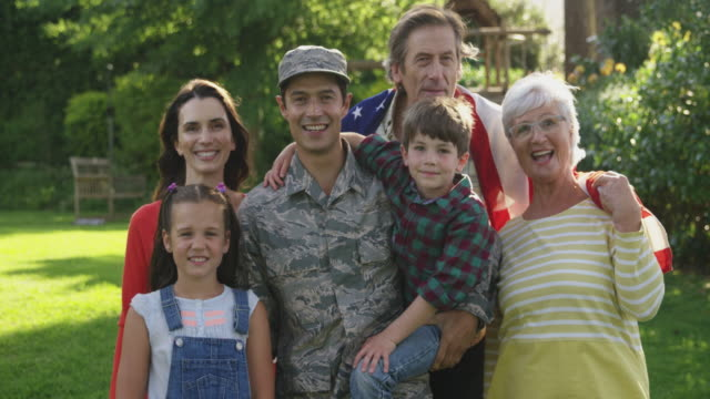 portrait of soldier with his family - military lifestyle stock videos & royalty-free footage
