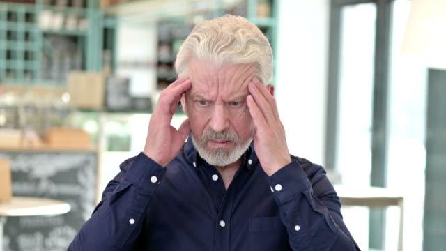 Portrait of Stressful Old Man Having Headache