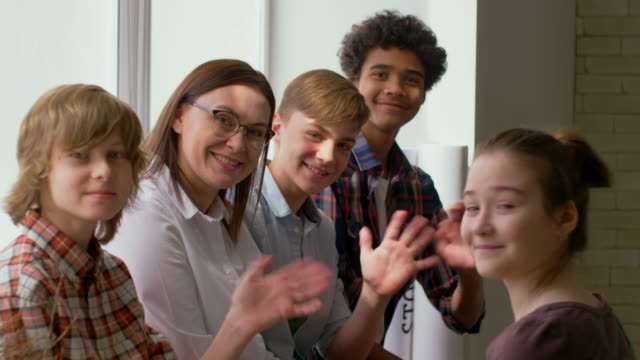 Portrait of Students and Teacher Waving Hands video
