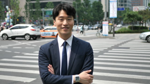 Portrait of successful Korean businessman with arms crossed Formal Korean businessman korean culture stock videos & royalty-free footage