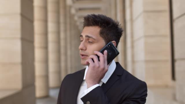 stockvideo's en b-roll-footage met portret van succesvolle advocaat met telefoontje - four lawyers
