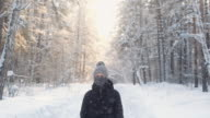 istock Portrait of teenager in winter knitted hat  scarf  in  winter snow forest. 1204230283