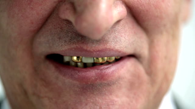 Portrait of the smiling old man with gold teeth video