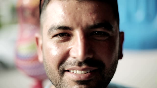 Portrait of the Turkish man of the seller on market video
