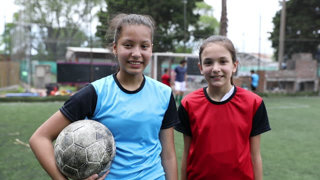 Portrait of two girl soccer players video