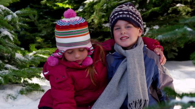 Portrait of two kids in winter video
