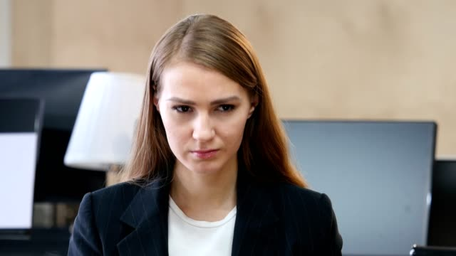 Portrait of Upset Sad Woman in Office video