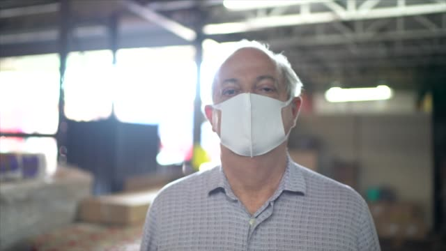 Portrait of warehouse worker with face mask