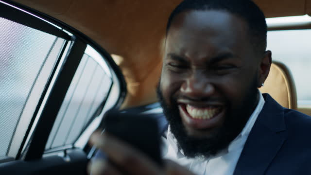 Portrait of winner african man business celebrating victory at luxury car.
