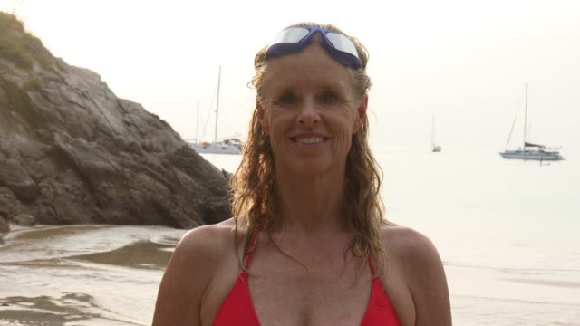 portrait of woman immediately after swim - эскапизм стоковые видео и кадры b-roll