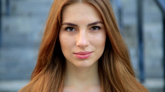 portrait of woman pretty caucasian woman with long hair smiling in the city - vicino video stock e b–roll