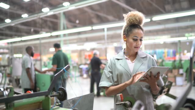 Portrait of woman using digital tablet in industry Portrait of woman using digital tablet in industry production line worker stock videos & royalty-free footage