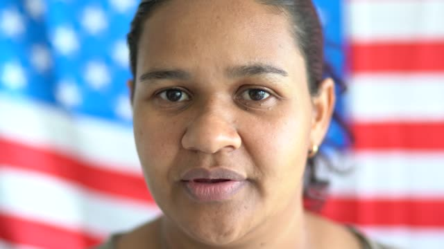 Portrait of woman with American flag on background Portrait of woman with American flag on background fourth of july videos stock videos & royalty-free footage