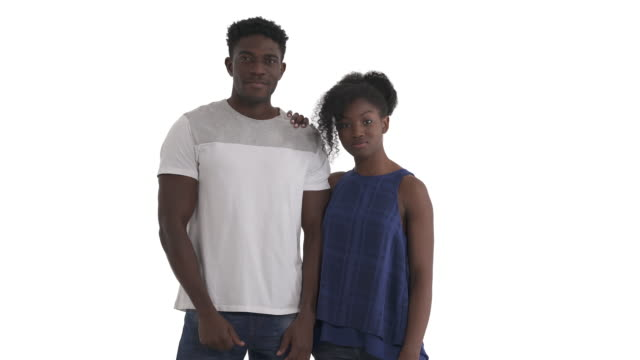 Portrait of young African American couple giving high five. raising together hands above their shoulders and slapping flats of palms. Isolated on white