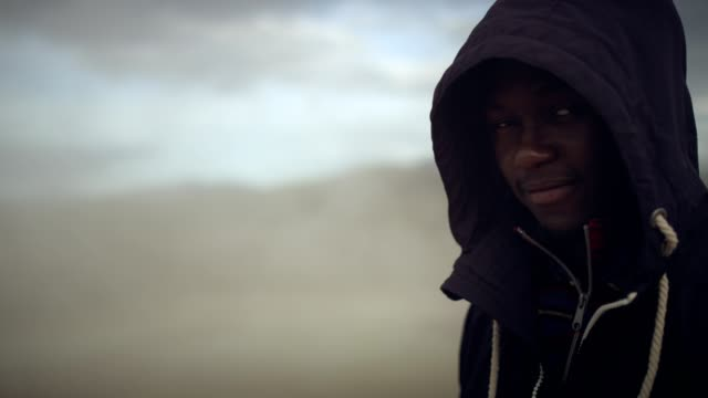 portrait of young african ethnicity man. geothermal area - fuggitivo video stock e b–roll