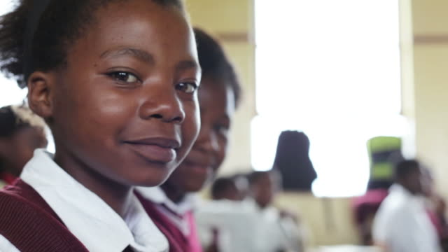 Portrait of young African school girl video