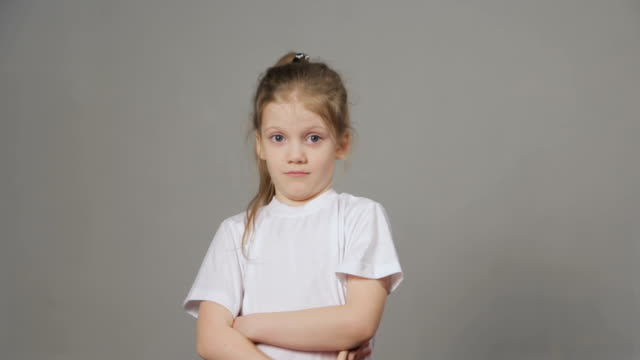 Portrait of young angry girl threatens with a shaking fist.