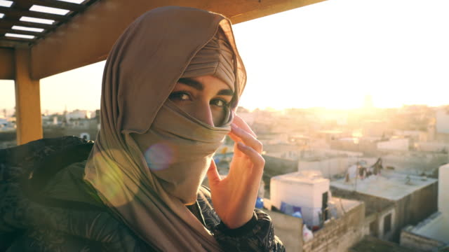 Portrait of young attractive muslim female in hijab. Looking at camera