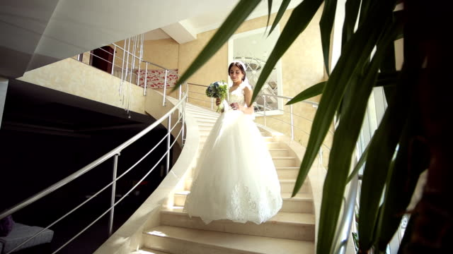 portrait of young beautiful bride on the stairs. - video di matrimonio video stock e b–roll