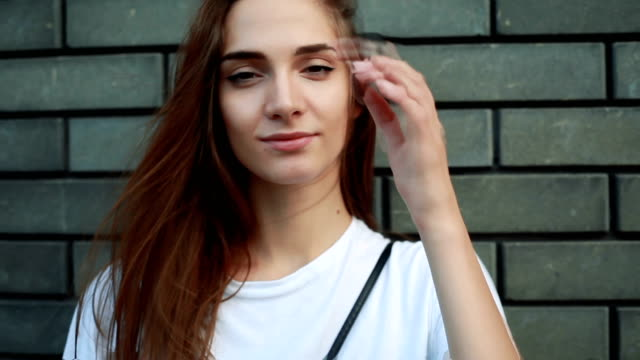portrait of young beautiful woman in white t-shirt et. - maglietta bianca video stock e b–roll