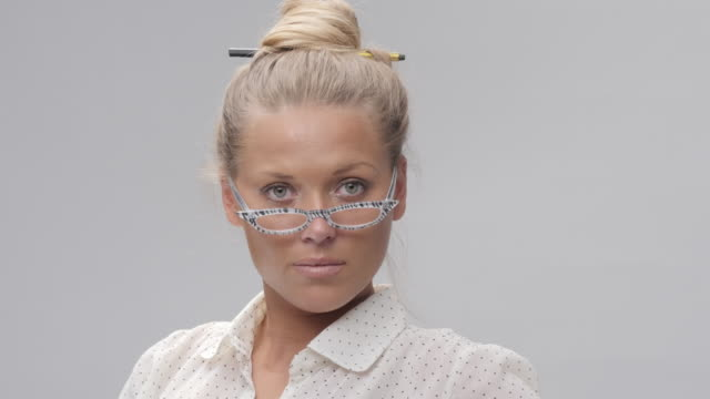 Portrait of Young, Blond, Cheerful Woman Trying New Glasses And Making Faces video