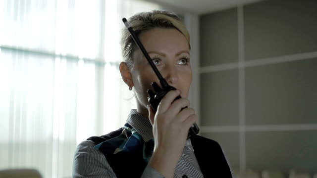 Portrait of young blonde talks to the walkie-talkie video