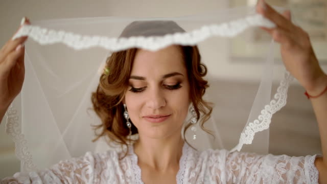 Portrait of young bride with veil video