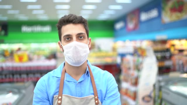 portrait of young business man owner with face mask at supermarket - essential workers stock videos & royalty-free footage