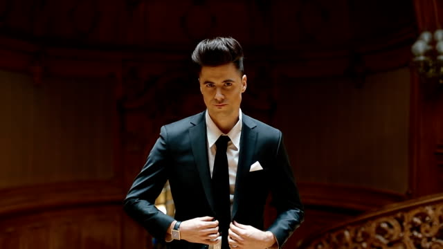 Portrait of young caucasian man in black suit video