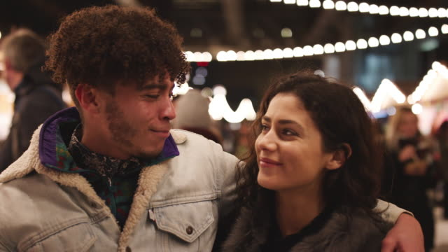 Portrait Of Young Couple Enjoying Christmas Market At Night video